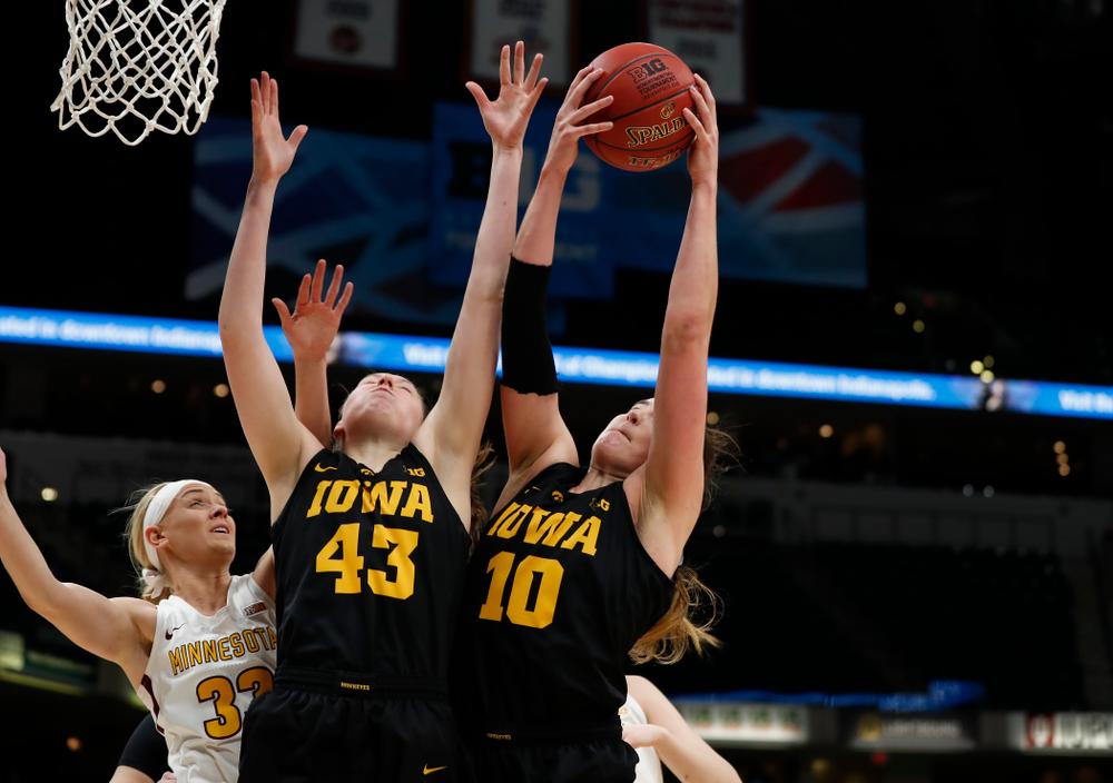 Iowa Hawkeyes forward Amanda Ollinger (43) and forward Megan Gustafson (10)