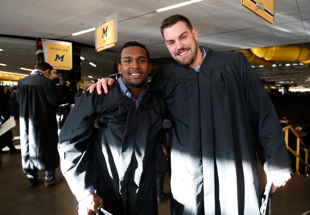 Iowa Hawkeyes defensive back Miles Taylor (19) and tight end Peter Pekar (86)