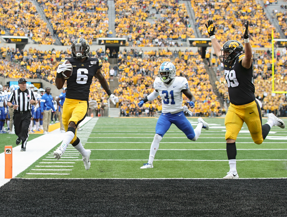 Iowa Hawkeyes wide receiver Ihmir Smith-Marsette (6) crosses the goal line on a 14-yard touchdown run as tight end Nate Wieting (39) raises his arms during third quarter of their game at Kinnick Stadium in Iowa City on Saturday, Sep 28, 2019. (Stephen Mally/hawkeyesports.com)