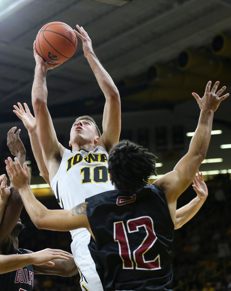 Iowa Hawkeyes guard Joe Wieskamp (10) goes up for a shot near the rim during a game against Guilford College at Carver-Hawkeye Arena on November 4, 2018. (Tork Mason/hawkeyesports.com)