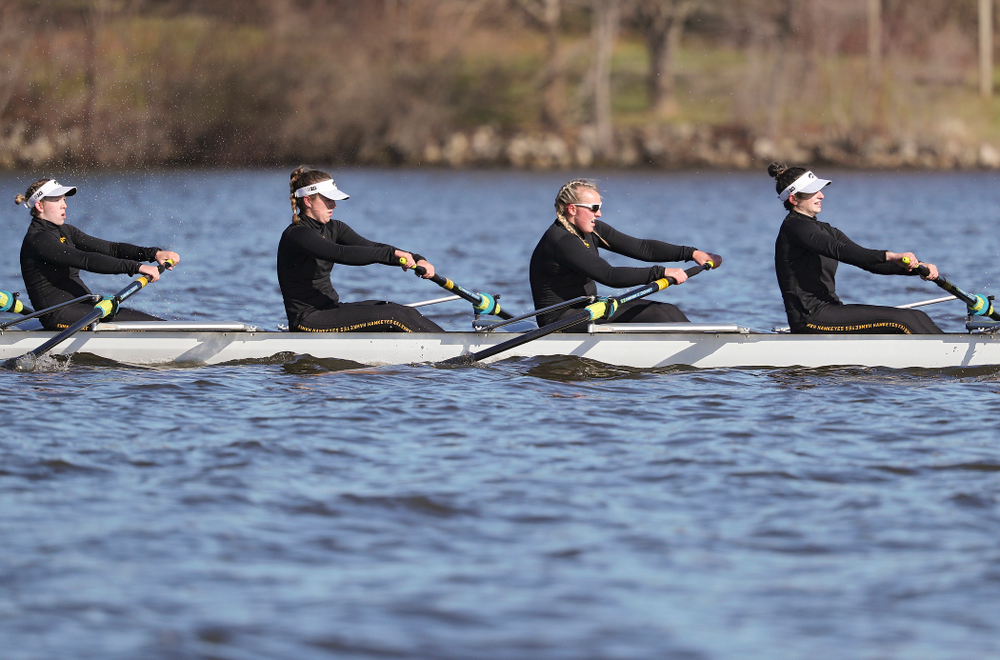 Iowa's Lauren Collier (from left), Noelle Ossenkop, Erika Davidson, and Riley Seufert during their I Novice 8 race against Wisconsin in their Big Ten Double Dual Rowing Regatta at Lake Macbride in Solon on Saturday, Apr. 13, 2019. (Stephen Mally/hawkeyesports.com)