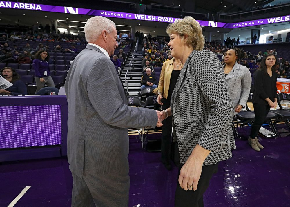 Northwestern Wildcats head coach Joe McKeown shakes hands with Iowa Hawkeyes head coach Lisa Bluder before their game at Welsh-Ryan Arena in Evanston, Ill. on Sunday, January 5, 2020. (Stephen Mally/hawkeyesports.com)