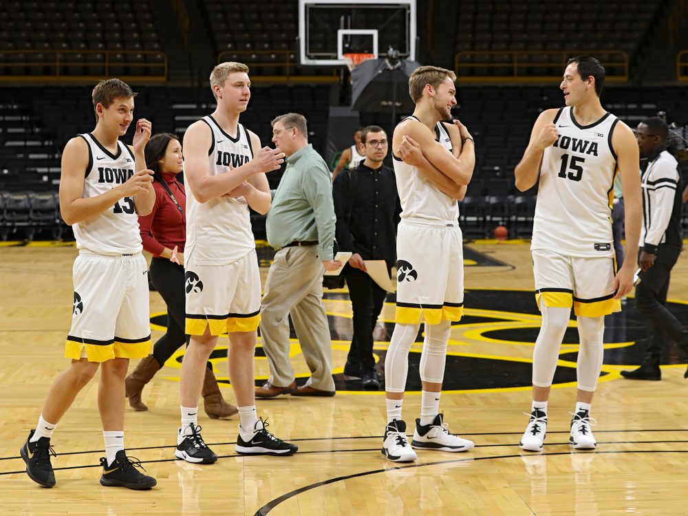 Iowa Hawkeyes guard Austin Ash (13), forward Michael Baer (0), forward Riley Till (20), and forward Ryan Kriener (15) during Iowa Men's Basketball Media Day at Carver-Hawkeye Arena in Iowa City on Wednesday, Oct 9, 2019. (Stephen Mally/hawkeyesports.com)