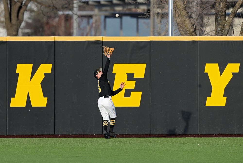 Iowa outfielder Justin Jenkins (6) runs down a fly ball for an out during the sixth inning of their college baseball game at Duane Banks Field in Iowa City on Tuesday, March 10, 2020. (Stephen Mally/hawkeyesports.com)