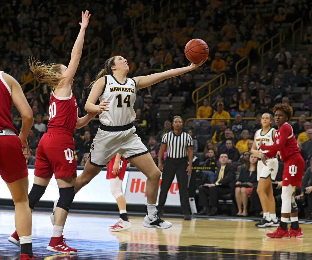 Iowa Hawkeyes guard Mckenna Warnock (14) makes a basket during the third quarter of their game at Carver-Hawkeye Arena in Iowa City on Sunday, January 12, 2020. (Stephen Mally/hawkeyesports.com)
