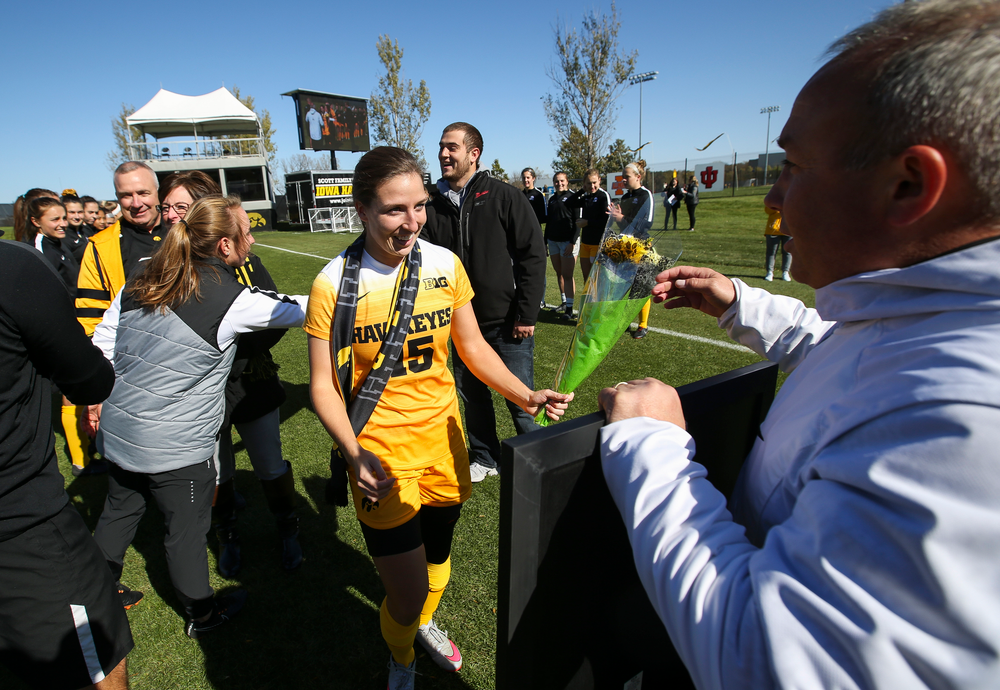 Iowa Hawkeyes head coach Dave DiIanni presents Iowa Hawkeyes forward Rose Ripslinger (15) with a framed photo during Senior Day ceremonies before a game against Northwestern at the Iowa Soccer Complex on October 21, 2018. (Tork Mason/hawkeyesports.com)