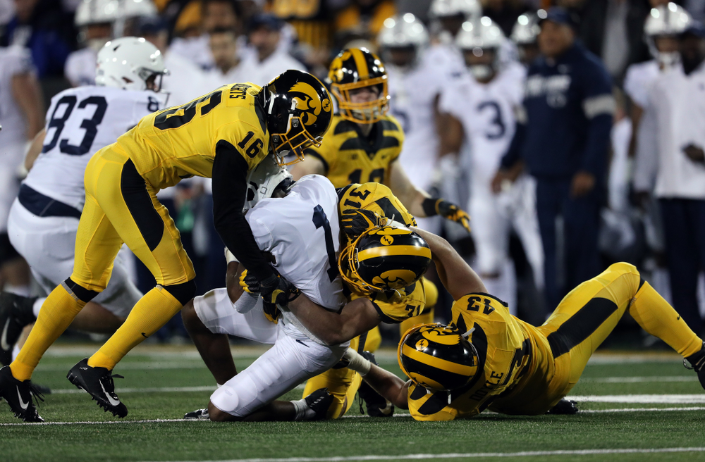 Iowa Hawkeyes defensive back Terry Roberts (16), linebacker Jack Campbell (31), and linebacker Dillon Doyle (43) against the Penn State Nittany Lions Saturday, October 12, 2019 at Kinnick Stadium. (Brian Ray/hawkeyesports.com)