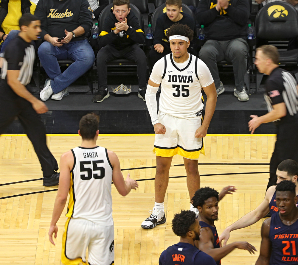 Iowa Hawkeyes forward Cordell Pemsl (35) celebrates after center Luka Garza (55) made a basket while being fouled during the first quarter of the game at Carver-Hawkeye Arena in Iowa City on Sunday, February 2, 2020. (Stephen Mally/hawkeyesports.com)