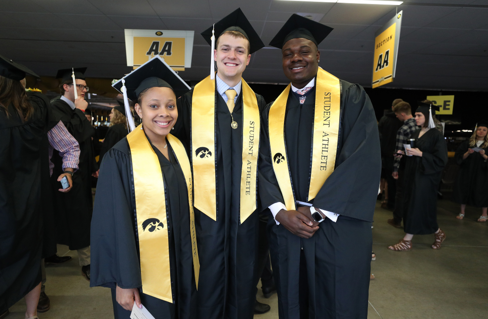 Iowa WoemenÕs BasketballÕs Tania Davis, SwimmingÕs Ben Colin, and FootballÕs James Daniels during the College of Liberal Arts and Sciences spring commencement Saturday, May 11, 2019 at Carver-Hawkeye Arena. (Brian Ray/hawkeyesports.com)