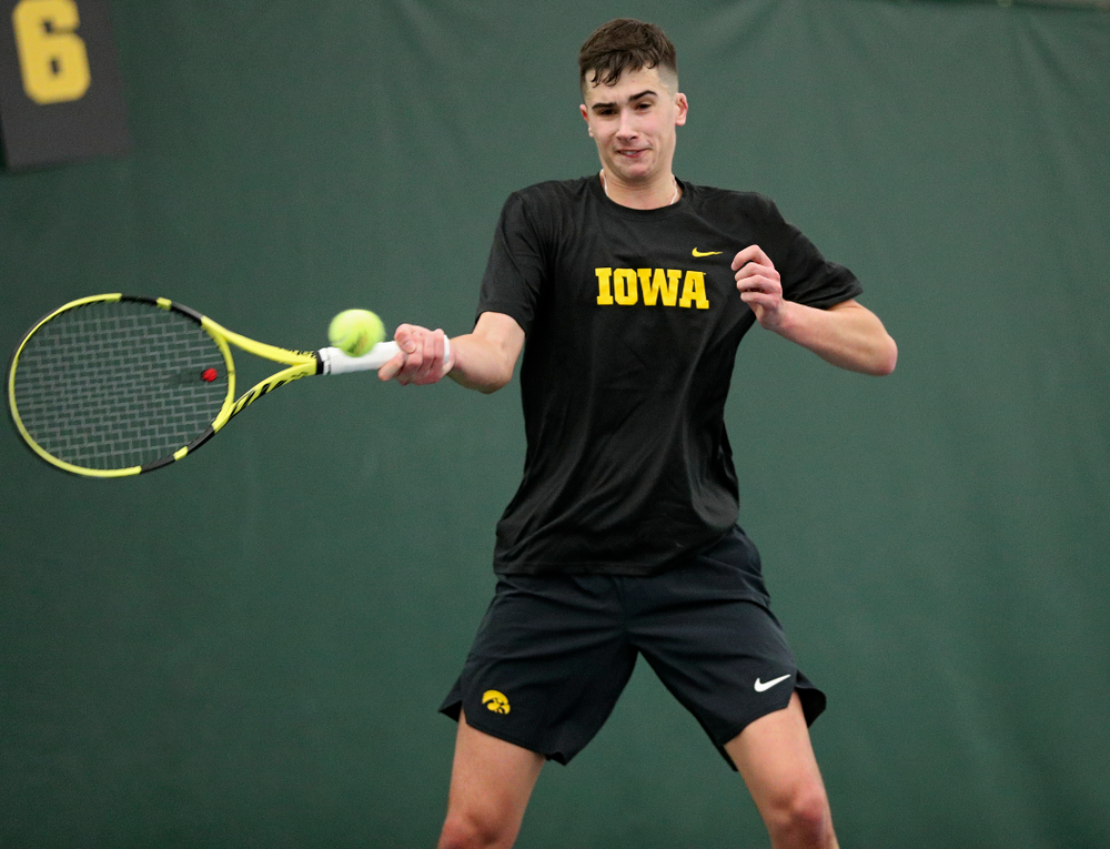 Iowa's Matt Clegg returns a shot during their match at the Hawkeye Tennis and Recreation Complex in Iowa City on Thursday, January 16, 2020. (Stephen Mally/hawkeyesports.com)