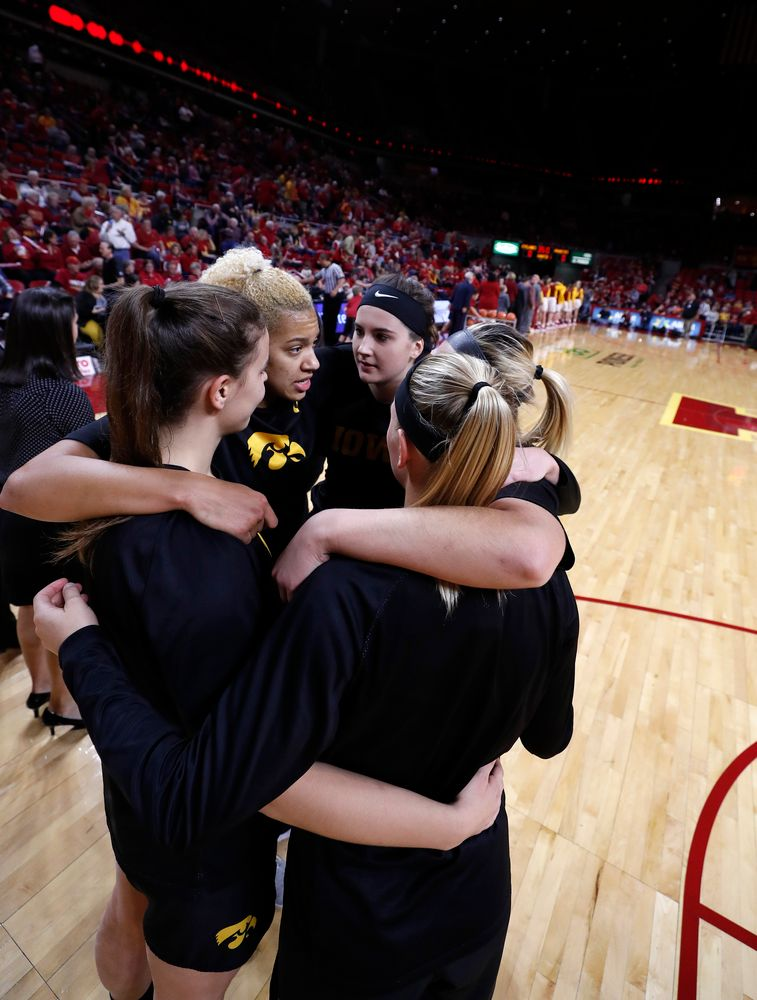 Iowa Hawkeyes forward Chase Coley (4) and forward Megan Gustafson (10)