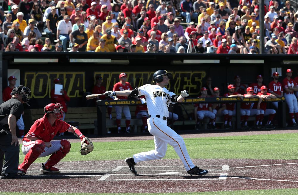 Iowa Hawkeyes outfielder Ben Norman (9) hits a home run  against the Nebraska Cornhuskers Saturday, April 20, 2019 at Duane Banks Field. (Brian Ray/hawkeyesports.com)