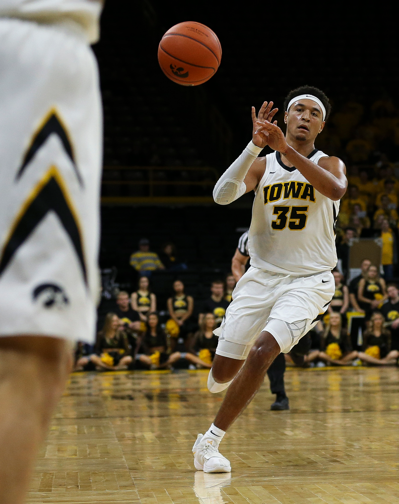 Iowa Hawkeyes forward Cordell Pemsl (35) passes the ball during a game against Guilford College at Carver-Hawkeye Arena on November 4, 2018. (Tork Mason/hawkeyesports.com)