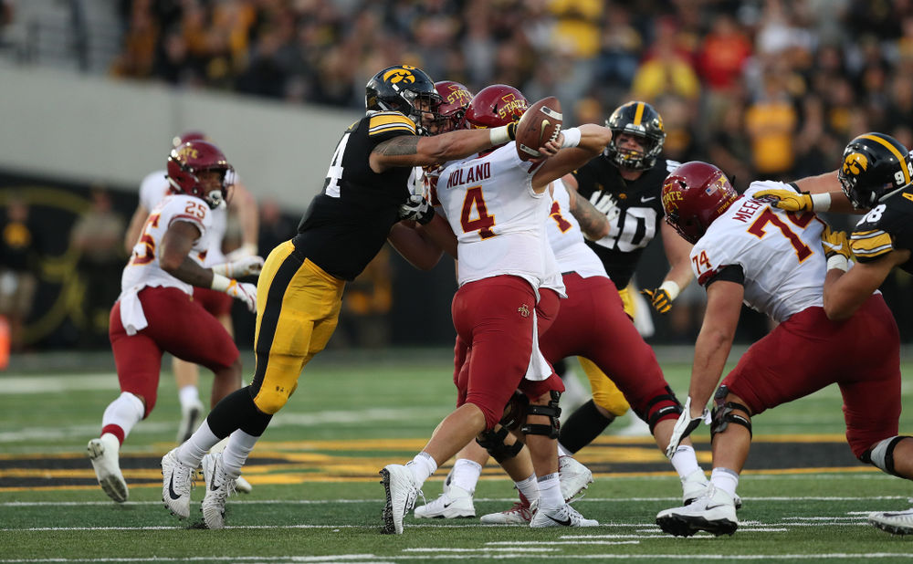 Iowa Hawkeyes defensive end A.J. Epenesa (94) strips the ball from Iowa State Cyclones quarterback Zeb Noland (4) Saturday, September 8, 2018 at Kinnick Stadium. (Max Allen/hawkeyesports.com)