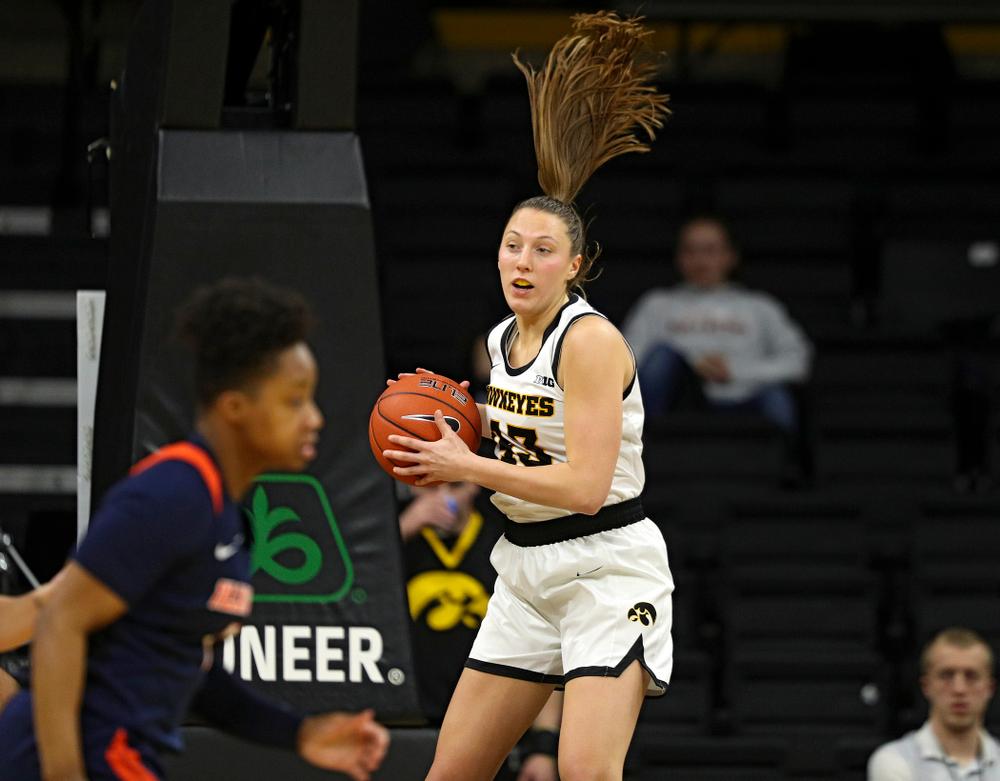 Iowa Hawkeyes forward Amanda Ollinger (43) pulls down a rebound during the third quarter of their game at Carver-Hawkeye Arena in Iowa City on Tuesday, December 31, 2019. (Stephen Mally/hawkeyesports.com)