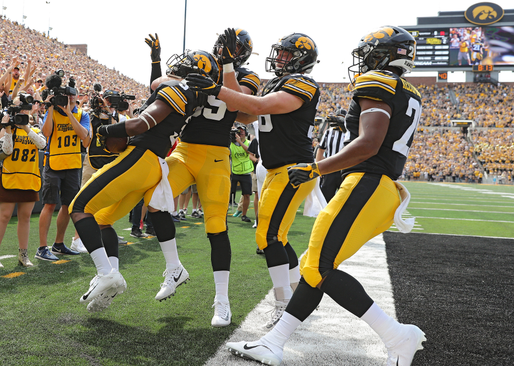 Iowa Hawkeyes wide receiver Tyrone Tracy Jr. (3) celebrates with tight end Nate Wieting (39), fullback Brady Ross (36), and running back Ivory Kelly-Martin (21) after his 7-yard touchdown reception during the second quarter of their Big Ten Conference football game at Kinnick Stadium in Iowa City on Saturday, Sep 7, 2019. (Stephen Mally/hawkeyesports.com)