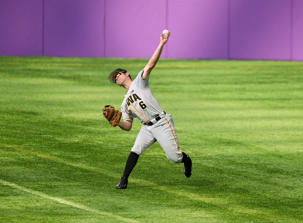 Iowa Hawkeyes outfielder Justin Jenkins (6) throws the ball back to the infield during the fourth inning of their CambriaCollegeClassic game at U.S. Bank Stadium in Minneapolis, Minn. on Friday, February 28, 2020. (Stephen Mally/hawkeyesports.com)