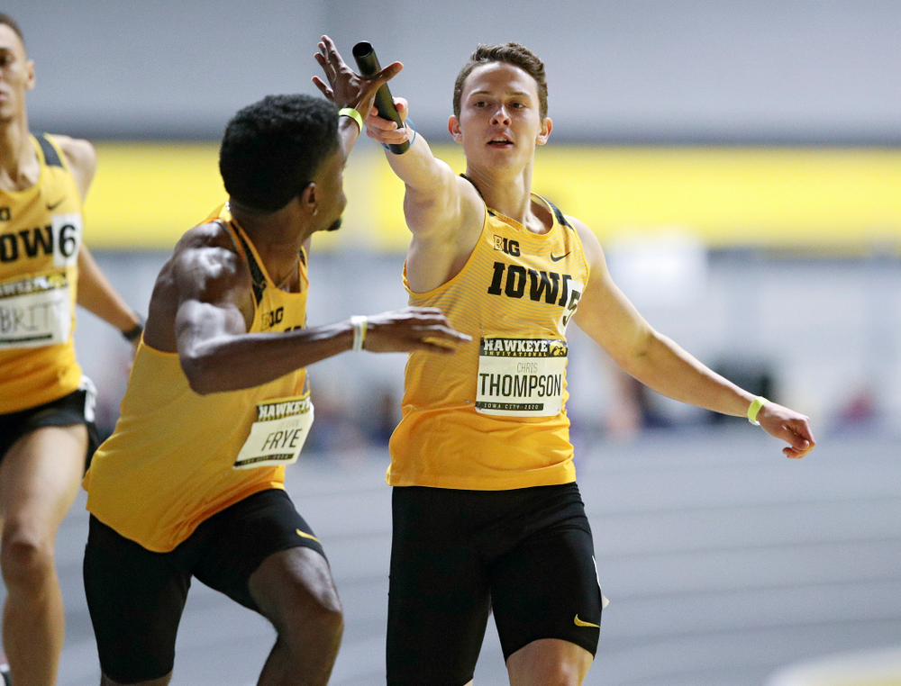 Iowa's Christ Thompson (right) hands the baton off to DeJuan Frye as they run the men's 1600 meter relay event during the Hawkeye Invitational at the Recreation Building in Iowa City on Saturday, January 11, 2020. (Stephen Mally/hawkeyesports.com)