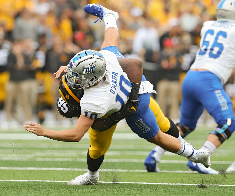 Iowa Hawkeyes defensive lineman Cedrick Lattimore (95) brings down Middle Tennessee State quarterback Asher O'Hara (10) during the first quarter of their game at Kinnick Stadium in Iowa City on Saturday, Sep 28, 2019. (Stephen Mally/hawkeyesports.com)