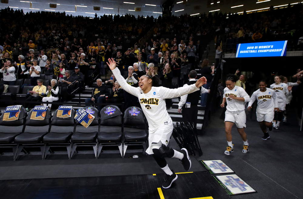 Iowa Hawkeyes guard Tania Davis (11) leads the team onto the court during the first round of the 2019 NCAA Women's Basketball Tournament at Carver Hawkeye Arena in Iowa City on Friday, Mar. 22, 2019. (Stephen Mally for hawkeyesports.com)
