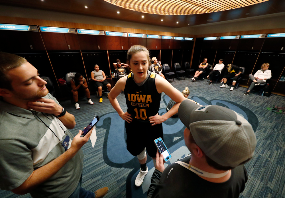 Iowa Hawkeyes forward Megan Gustafson (10) answers questions from reporters before practice Friday, March 16, 2018 at Pauley Pavilion on the campus of UCLA. (Brian Ray/hawkeyesports.com)