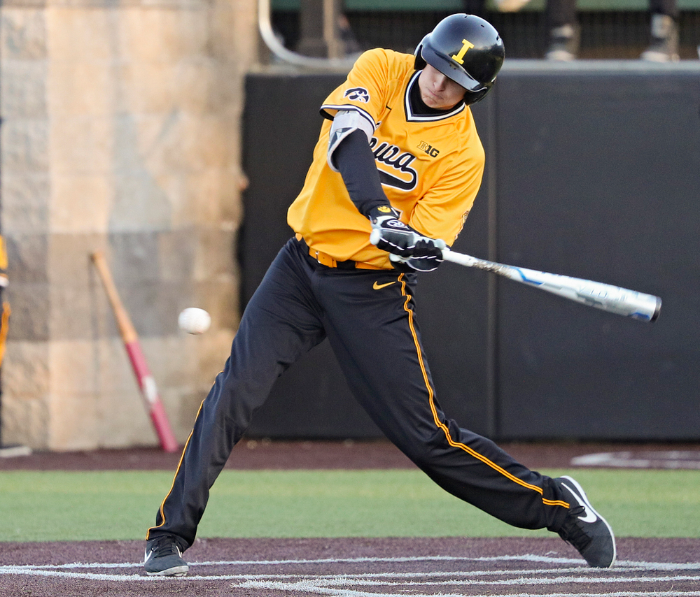 Iowa Hawkeyes pinch hitter Grant Judkins (7) drives a pitch for a hit during the eighth inning of their game at Duane Banks Field in Iowa City on Tuesday, Apr. 2, 2019. (Stephen Mally/hawkeyesports.com)