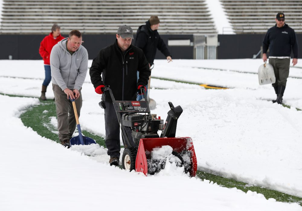 Members of the Iowa Athletics Turf Management staff create the #SnowWave for kids in the Stead Family Children's Hospital Thursday, February