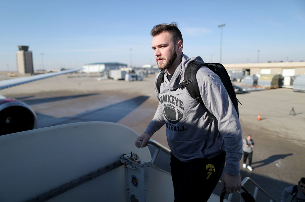 Iowa Hawkeyes punter Colten Rastetter (7) boards the team plane at the Eastern Iowa Airport Saturday, December 21, 2019 on the way to San Diego, CA for the Holiday Bowl. (Brian Ray/hawkeyesports.com)