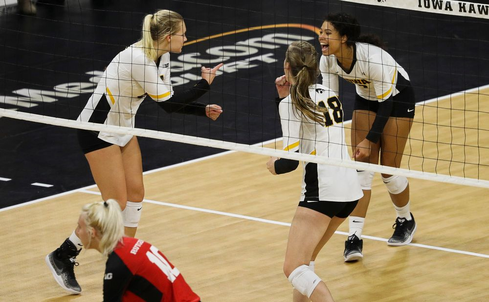 Iowa Hawkeyes right side hitter Reghan Coyle (8) and Iowa Hawkeyes setter Brie Orr (7) celebrate after winning a point during a match against Rutgers at Carver-Hawkeye Arena on November 2, 2018. (Tork Mason/hawkeyesports.com)