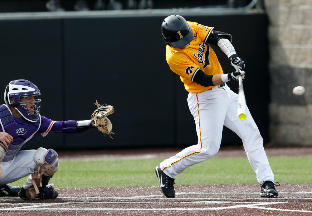 Iowa Hawkeyes catcher Tyler Cropley (5) hits an RBI single in the eighth inning during a game against Evansville at Duane Banks Field on March 18, 2018. (Tork Mason/hawkeyesports.com)
