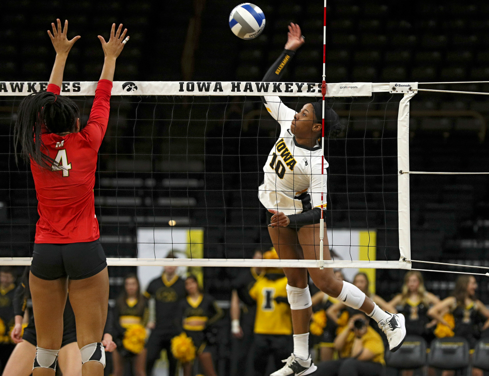 Iowa's Griere Hughes (10) lines up a kill during the third set of their match at Carver-Hawkeye Arena in Iowa City on Saturday, Nov 30, 2019. (Stephen Mally/hawkeyesports.com)