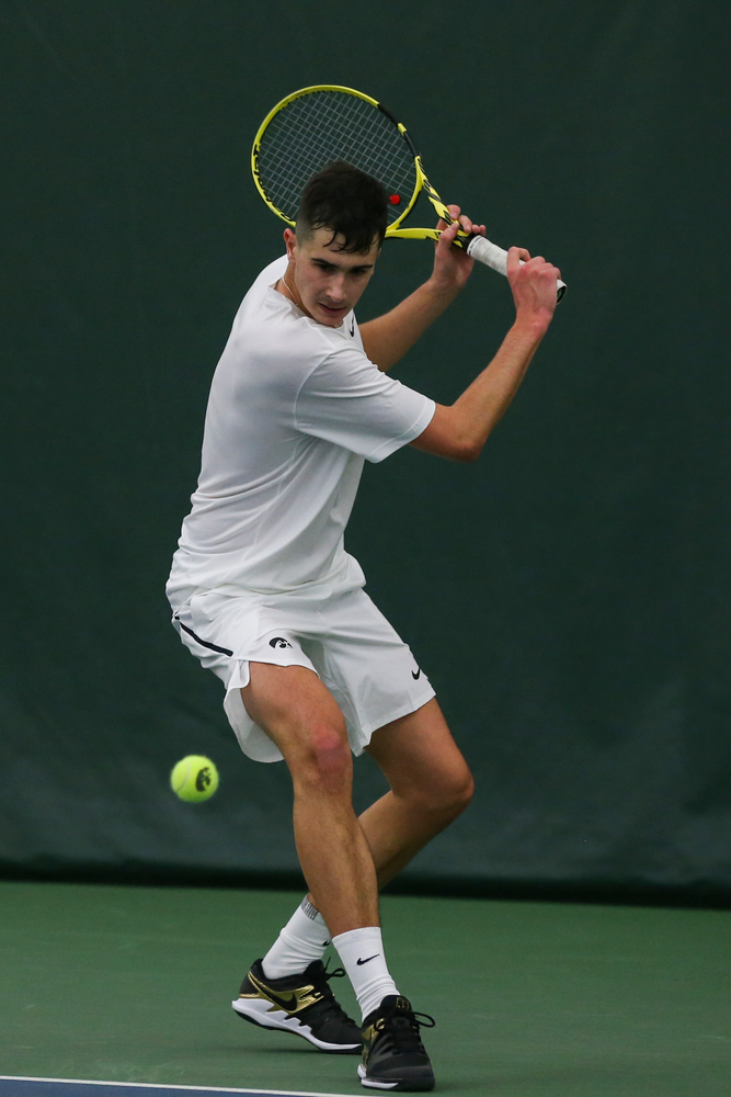 Iowa's Matt Clegg prepares to hit a backhand during the Iowa men's tennis match vs Western Michigan on Saturday, January 18, 2020 at the Hawkeye Tennis and Recreation Complex. (Lily Smith/hawkeyesports.com)