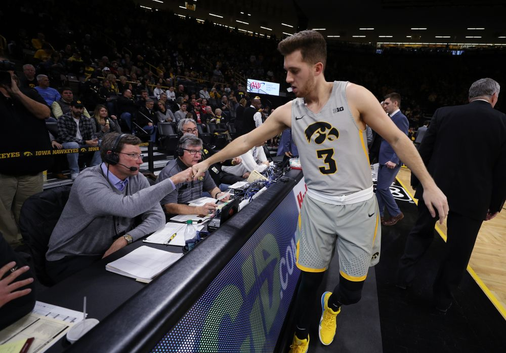 Iowa Hawkeyes guard Jordan Bohannon (3) fist bumps radio announcer Bobby Hansen before their game against the Nebraska Cornhuskers Sunday, January 6, 2019 at Carver-Hawkeye Arena. (Brian Ray/hawkeyesports.com)