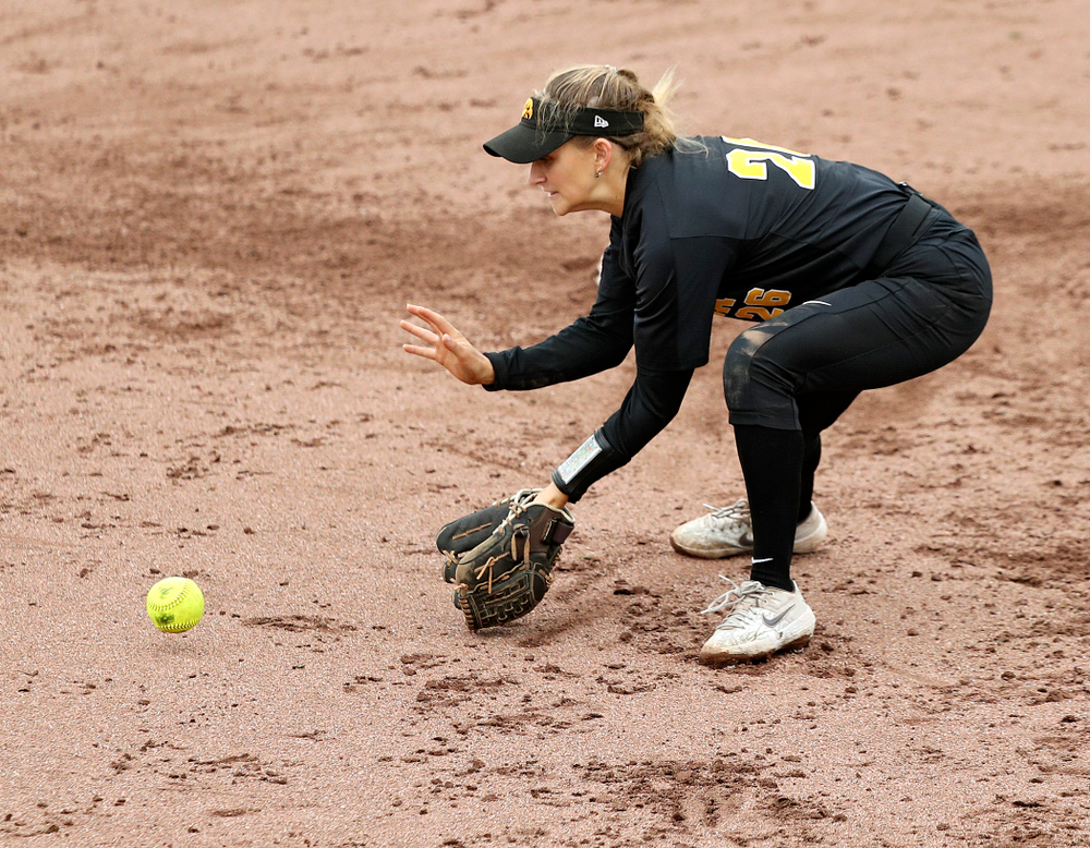 Iowa infielder Mia Ruther (26) fields a ground ball before throwing to first for an out during the sixth inning of their game against Iowa Softball vs Indian Hills Community College at Pearl Field in Iowa City on Sunday, Oct 6, 2019. (Stephen Mally/hawkeyesports.com)