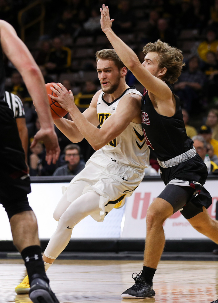 Iowa Hawkeyes forward Riley Till (20) drives to the basket during a game against Guilford College at Carver-Hawkeye Arena on November 4, 2018. (Tork Mason/hawkeyesports.com)