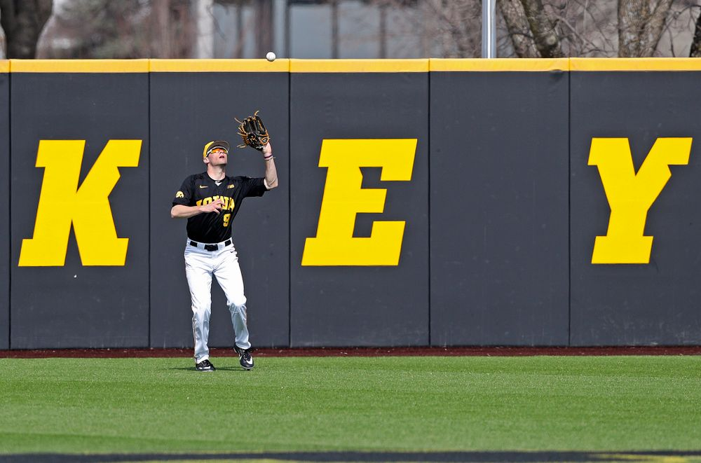 Iowa Hawkeyes center fielder Ben Norman (9) pulls in a fly ball for an out during the fifth inning of their game against Rutgers at Duane Banks Field in Iowa City on Saturday, Apr. 6, 2019. (Stephen Mally/hawkeyesports.com)