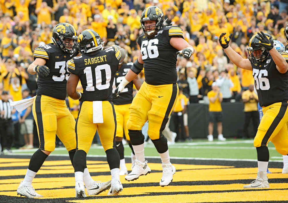 Iowa Hawkeyes running back Mekhi Sargent (10) celebrates his 4-yard touchdown run with tight end Nate Wieting (39) and offensive lineman Levi Paulsen (66) during the first quarter of their game at Kinnick Stadium in Iowa City on Saturday, Sep 28, 2019. (Stephen Mally/hawkeyesports.com)