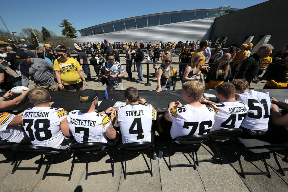 Members of the Iowa Football team sign autographs before the Iowa Hawkeyes game against the Nebraska Cornhuskers Saturday, April 20, 2019 at Duane Banks Field. (Brian Ray/hawkeyesports.com)