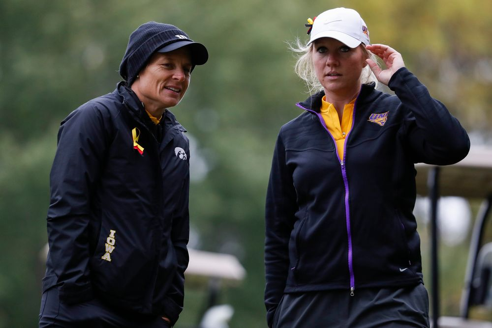 Iowa head coach Megan Menzel and Northern Iowa assistant coach Jessie Sindlinger chat while watching first round action during the Diane Thomason Invitational at Finkbine Golf Course on September 29, 2018. (Tork Mason/hawkeyesports.com)