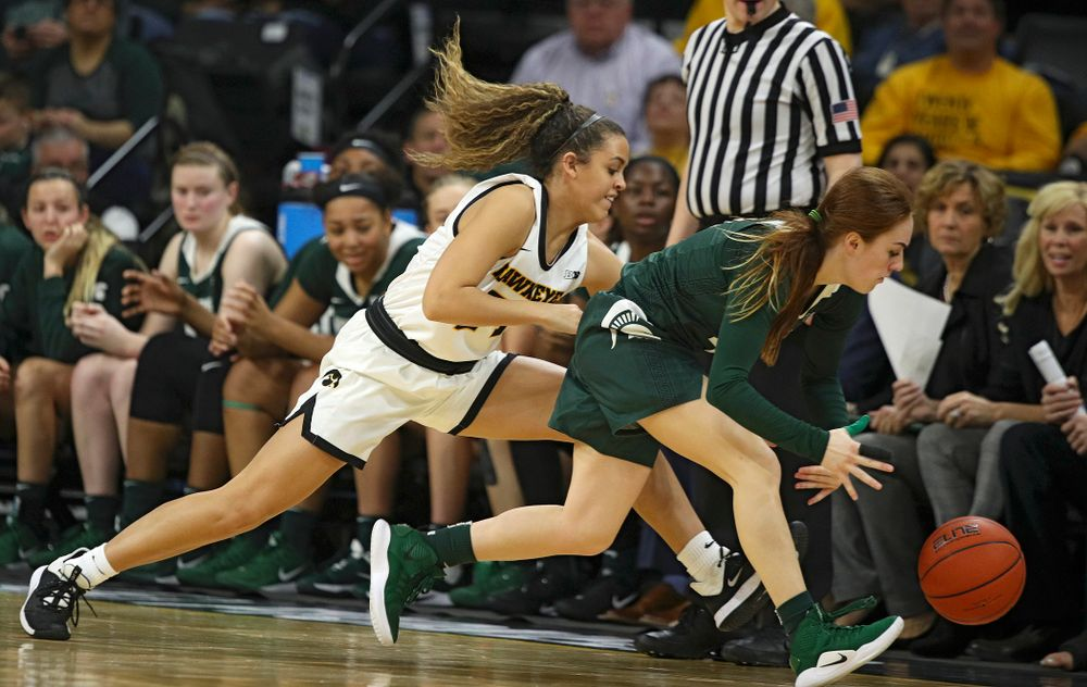 Iowa Hawkeyes guard Gabbie Marshall (24) pressures Michigan State Spartans guard Taryn McCutcheon (4) which led to a turnover during the fourth quarter of their game at Carver-Hawkeye Arena in Iowa City on Sunday, January 26, 2020. (Stephen Mally/hawkeyesports.com)