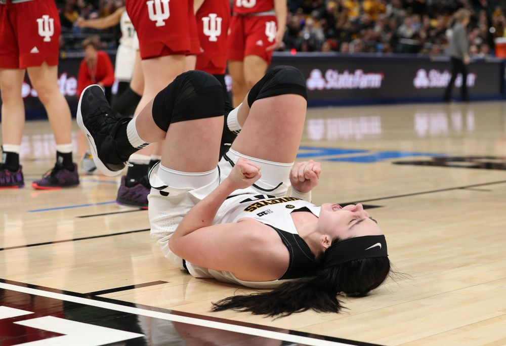 Iowa Hawkeyes forward Megan Gustafson (10) celebrates after making a basket and drawing a foul against the Indiana Hoosiers in the quarterfinals of the Big Ten Tournament Friday, March 8, 2019 at Bankers Life Fieldhouse in Indianapolis, Ind. (Brian Ray/hawkeyesports.com)