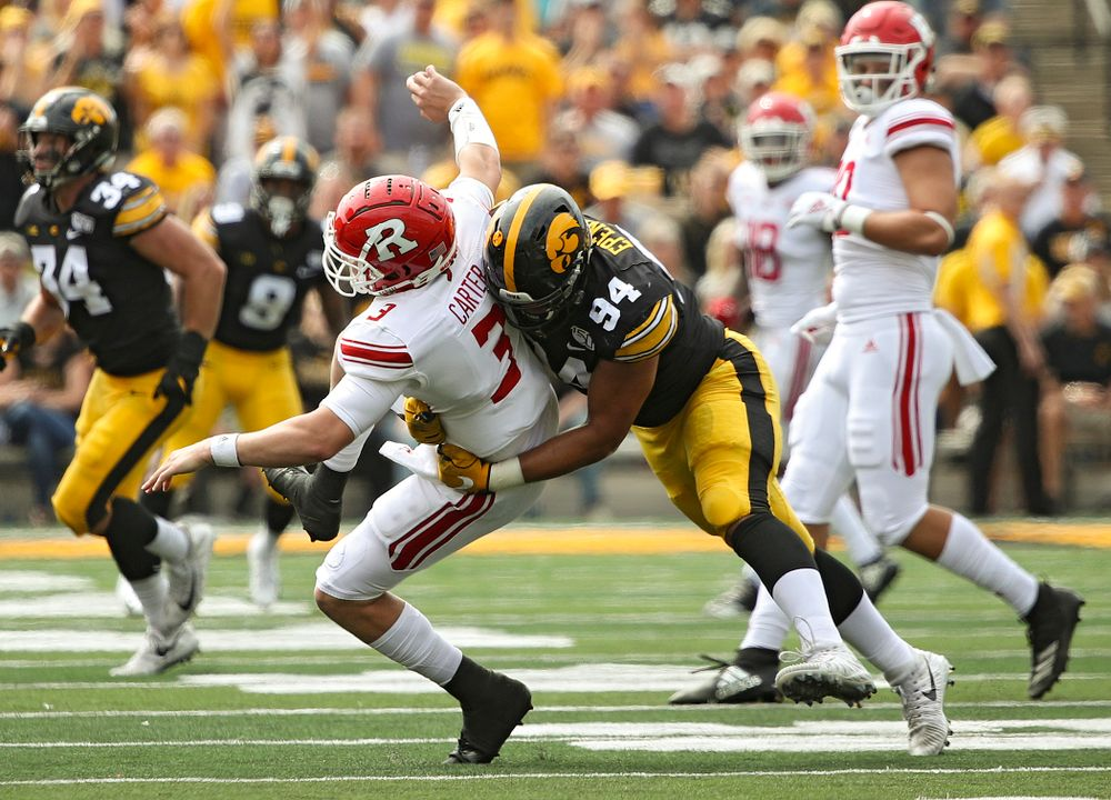 Iowa Hawkeyes defensive end A.J. Epenesa (94) hits Rutgers quarterback McLane Carter during the second quarter of their Big Ten Conference football game at Kinnick Stadium in Iowa City on Saturday, Sep 7, 2019. (Stephen Mally/hawkeyesports.com)