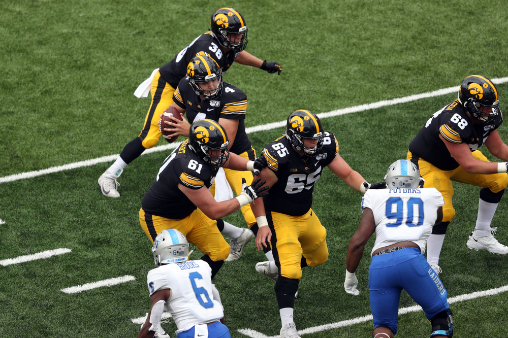 Iowa Hawkeyes quarterback Nate Stanley (4), offensive lineman Cole Banwart (61), offensive lineman Tyler Linderbaum (65), and offensive lineman Landan Paulsen (68) against Middle Tennessee State Saturday, September 28, 2019 at Kinnick Stadium. (Brian Ray/hawkeyesports.com)