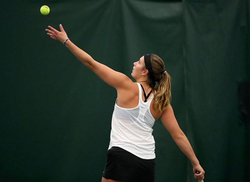 Iowa's Ashleigh Jacobs serves during her singles match at the Hawkeye Tennis and Recreation Complex in Iowa City on Sunday, February 23, 2020. (Stephen Mally/hawkeyesports.com)
