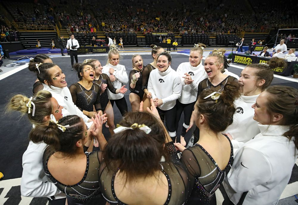 The Hawkeyes huddle after their meet at Carver-Hawkeye Arena in Iowa City on Sunday, March 8, 2020. (Stephen Mally/hawkeyesports.com)
