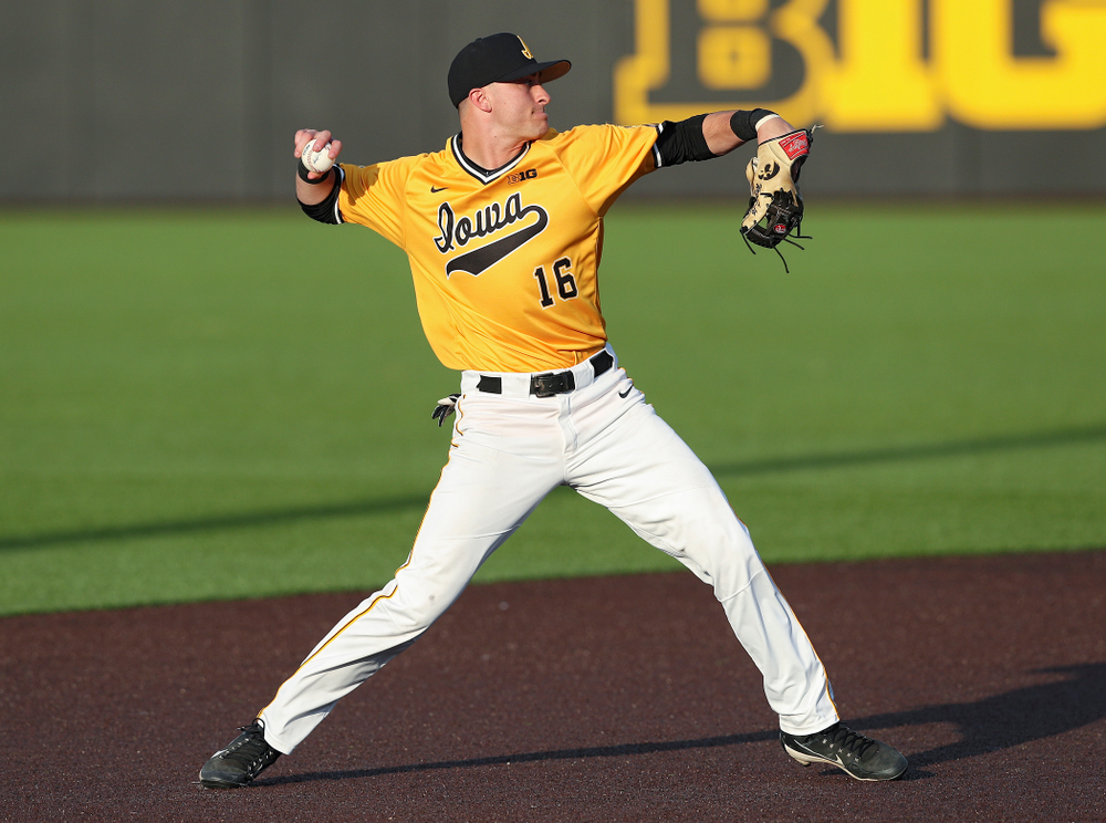 Iowa Hawkeyes shortstop Tanner Wetrich (16) throws to first base for an out during the seventh inning of their game against Northern Illinois at Duane Banks Field in Iowa City on Tuesday, Apr. 16, 2019. (Stephen Mally/hawkeyesports.com)