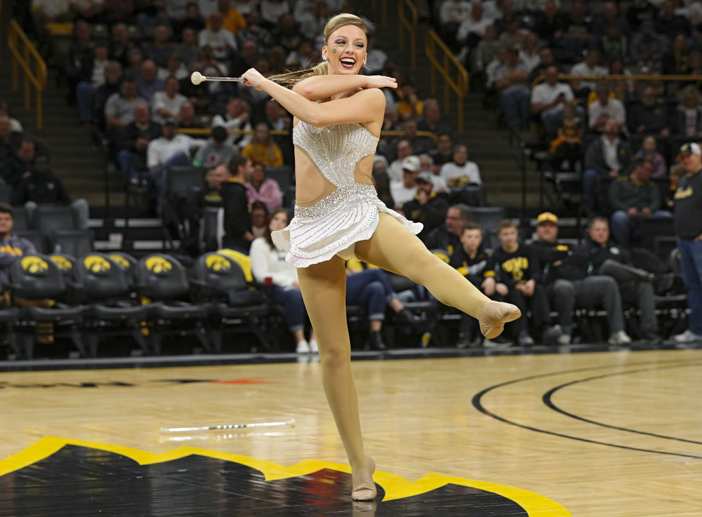 Iowa Golden Girl Kylene Spanbauer performs during halftime of the game at Carver-Hawkeye Arena in Iowa City on Sunday, February 2, 2020. (Stephen Mally/hawkeyesports.com)