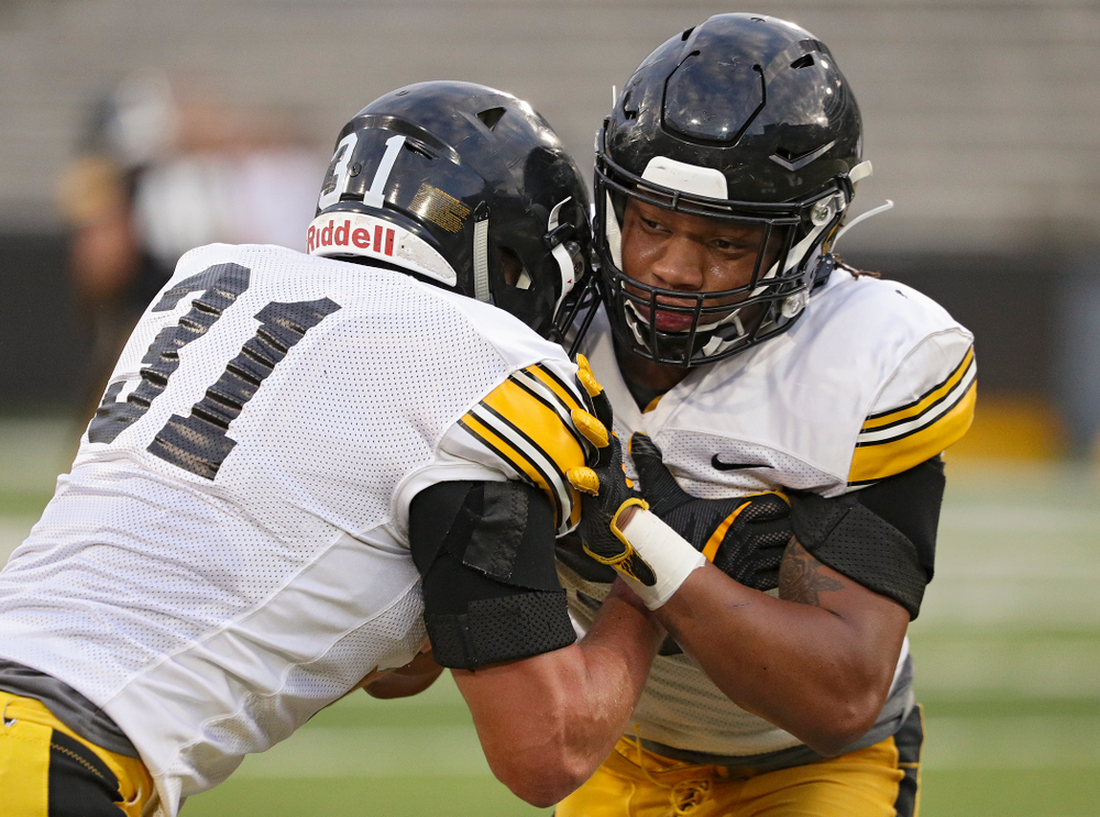 Iowa Hawkeyes linebacker Jack Campbell (from left) and linebacker Jestin Jacobs run a drill during Fall Camp Practice No. 12 at Kinnick Stadium in Iowa City on Thursday, Aug 15, 2019. (Stephen Mally/hawkeyesports.com)