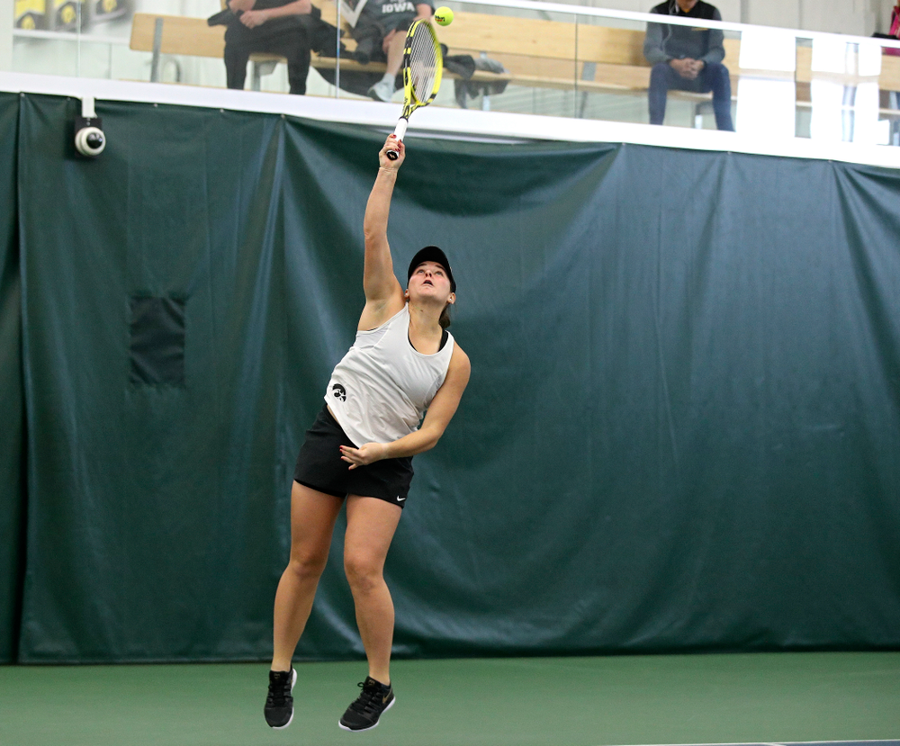 Iowa's Danielle Bauers serves during her doubles match at the Hawkeye Tennis and Recreation Complex in Iowa City on Sunday, February 23, 2020. (Stephen Mally/hawkeyesports.com)