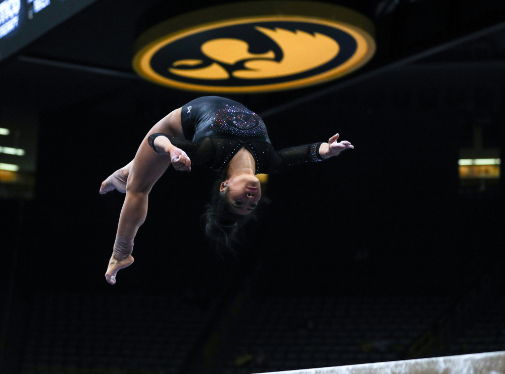 Iowa's Claire Kaji competes on the beam against Michigan Friday, February 14, 2020 at Carver-Hawkeye Arena. (Brian Ray/hawkeyesports.com)